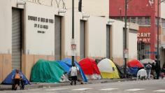 Tents and tarps erected by homeless people are shown along the sidewalks in the skid row area of downtown Los Angeles, California