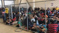 An overcrowded fenced area holding families at a Border Patrol station is seen in McAllen