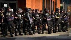 Police stand guard on Broadway as protesters march in downtown Nashville, Tenn., Thursday, June 4, 2020. Protests continued in