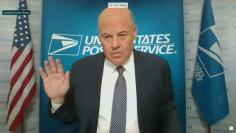 U.S. Postmaster General Louis DeJoy is sworn in to testify via video feed during a virtual hearing of the U.S. Senate Homeland Security and Governmental Affairs Committee in Washington