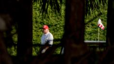 President Donald Trump plays golf at his Trump International Golf Club in West Palm Beach, Florida on December 28, 2020.WPB