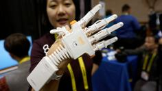 Anna Choi of Neofect demonstrates the Rapael Smart Glove therapy device for stroke victims at CES in Las Vegas