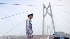 A worker stands on the Hong Kong-Zhuhai-Macau bridge under construction in Zhuhai