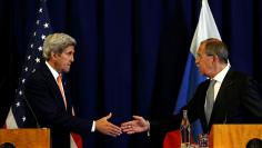 John Kerry and Russian Foreign Minister Sergei Lavrov hold a news conference in Geneva