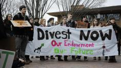 Tufts University students demonstrating for disinvestment from fossil fuels, 2013
