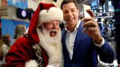Tom Farley, president of the NYSE Group, poses for a selfie with Santa Claus who rang the opening bell to celebrate the Macy's 90th Annual Thanksgiving Day Parade at the NYSE