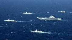 China's Liaoning aircraft carrier with accompanying fleet conducts a drill in an area of South China Sea