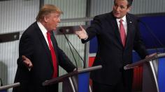 Republican U.S. presidential candidate Trump and Cruz speak simultaneously at the Fox Business Network Republican presidential candidates debate in North Charleston