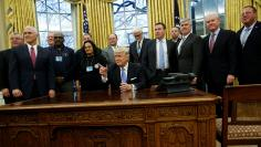 Trump gathers labor leaders in the Oval Office after their meeting at the White House in Washington