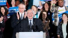 Democratic U.S. presidential candidate Bernie Sanders smiles after winning at his 2016 New Hampshire presidential primary night rally in Concord