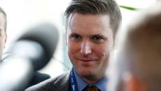 "Richard Spencer, a leader and spokesperson for the so-called ""alt-right"" movement, speaks to the media at the Conservative Political Action Conference (CPAC) in National Harbor, Maryland"