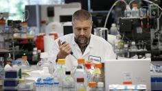 Research scientist Dan Galperin works in the research labaratory at Protein Sciences Inc. where they are working on developing a vaccine for the Zika virus in Meriden