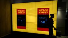 A customer leaves an ATM at the Wells Fargo & Co. bank in downtown Denver