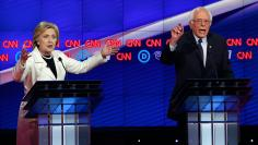 Democratic U.S. presidential candidates Clinton and Sanders speak simultaneously during a Democratic debate in New York