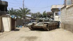 A tank of the Iraqi security forces is seen in the town of Hit