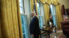 U.S. President Trump looks out window of the Oval Office following an interview with Reuters at the White House in Washington
