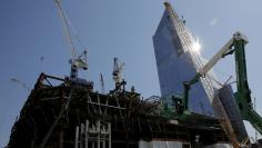 Construction cranes tower over the base of the 30 Hudson Yards building, Wells Fargo & Co.'s future offices in New York