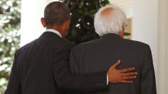 Democratic presidential candidate Bernie Sanders walks with President Obama at the White House in Washington