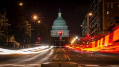 A red traffic light stands in front of the U.S. Capitol building in Washington