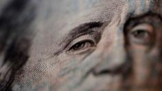 A portrait of Benjamin Franklin on a U.S. One-hundred dollar bill is pictured at Interbank Inc. money exchange in Tokyo