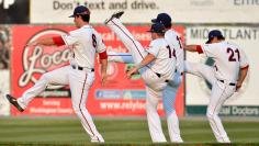 Minor League baseball players stretch in Maryland before game