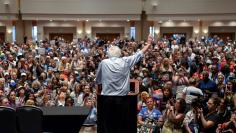 Senator Bernie Sander waves farewell to his electoral delegates gathered at the Convention Center during the Democratic National Convention in Philadelphia