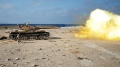A fighter of Libyan forces allied with the U.N.-backed government fires a shell with Soviet made T-55 tank at Islamic State fighters in Sirte