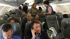 Passengers board the first regularly scheduled commercial flight between the United States and Cuba in more than half a century at Fort Lauderdale International airport in Fort Lauderdale