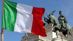 "The Italian flag waves in front of The ""Altare della Patria"" also known as ""Vittoriano"" downtown Rome"