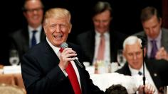Republican presidential nominee Donald Trump gestures as he speaks to the Economic Club of New York luncheon in Manhattan