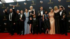"The cast of HBO's ""Game of Thrones"" pose backstage with their awardS at the 68th Primetime Emmy Awards in Los Angeles, California"