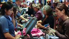 Black Friday customers make purchases at a Disney store at the Glendale Galleria in Glendale, California