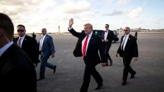 U.S. President Donald Trump and U.S. first lady Melania Trump arrive aboard Air Force One at Palm Beach International Airport