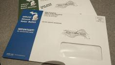 The new look of absentee ballot envelopes that will arrive in the mail for those who request them, top, and the envelopes