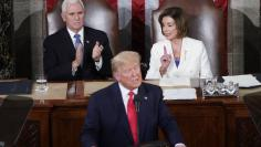 Vice President Pence and Speaker of the House Pelosi (D-CA) listen as U.S. President Donald Trump delivers the State of the Union address at the U.S. Capitol in Washington