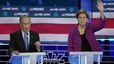 Senator Elizabeth Warren waits to speak as former New York City Mayor Mike Bloomberg answers a question at the ninth Democratic 2020 U.S. Presidential candidates debate at the Paris Theater in Las Vegas