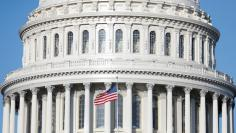 The American Flag flies at the U.S. Capitol Building, as Mayor Muriel Bowser declared a State of Emergency due to the coronavirus disease (COVID-19), on Capitol Hill in Washington