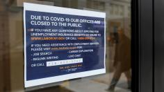 FILE PHOTO: Signage is seen posted on the entrance of the New York State Department of Labor offices, which closed to the public due to the coronavirus disease (COVID-19) outbreak in the Brooklyn borough of New York City