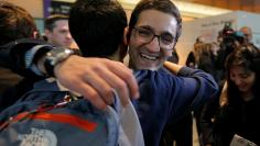 Behnam Partopour, a Worcester Polytechnic Institute student from Iran, is greeted by friends at Logan Airport after he cleared U.S. customs and immigration on an F1 student visa in Boston
