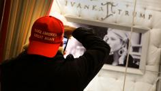 "A man wearing a ""Make America Great Again"" cap takes a picture of Ivanka Trump jewelry display window inside Trump Tower in New York City"