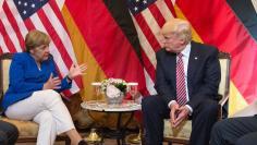German Chancellor Angela Merkel and U.S. President Donald Trump before talks at the G7 summit in Taormina