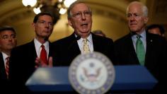 U.S. Senate Majority Leader Mitch McConnell, accompanied by Senator Cory Gardner (R-CO), Senator John Barrasso (R-WY) and Senator John Cornyn (R-TX), speaks with the media about the recently withdrawn healthcare bill on Capitol Hill in Washington