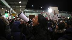 Protesters  gather outside Terminal 4 at JFK airport in opposition to U.S. President Donald Trump's proposed ban on immigration in Queen