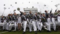 Graduating cadets toss their caps into the air at the conclusion of graduation ceremonies at the United States Military Academy at West Point