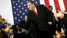 Supporters of U.S. Republican presidential candidate Chris Christie shake hands with Christie before he speaks at a campaign event in Bedford