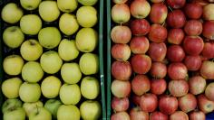 Apples are on display at a shop of a food market in Vienna