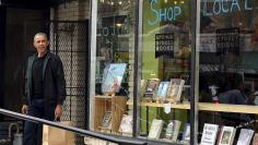 U.S. President Barack Obama departs Upshur Street Books after purchasing books with daughters Malia and Sasha, in Washington