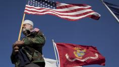 Navy Vietnam War veteran Dennis McClelland of Murrells Inlet, South Carolina, holds a U.S. flag during a Veterans March on Ocean Boulevard in honor of Memorial Day in Myrtle Beach