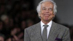 Designer Ralph Lauren acknowledges the crowd following the Fall/Winter 2012 collection during New York