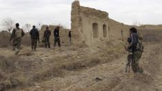 File photo of Afghan National Army (ANA) soldiers patrolling at an outpost in Helmand